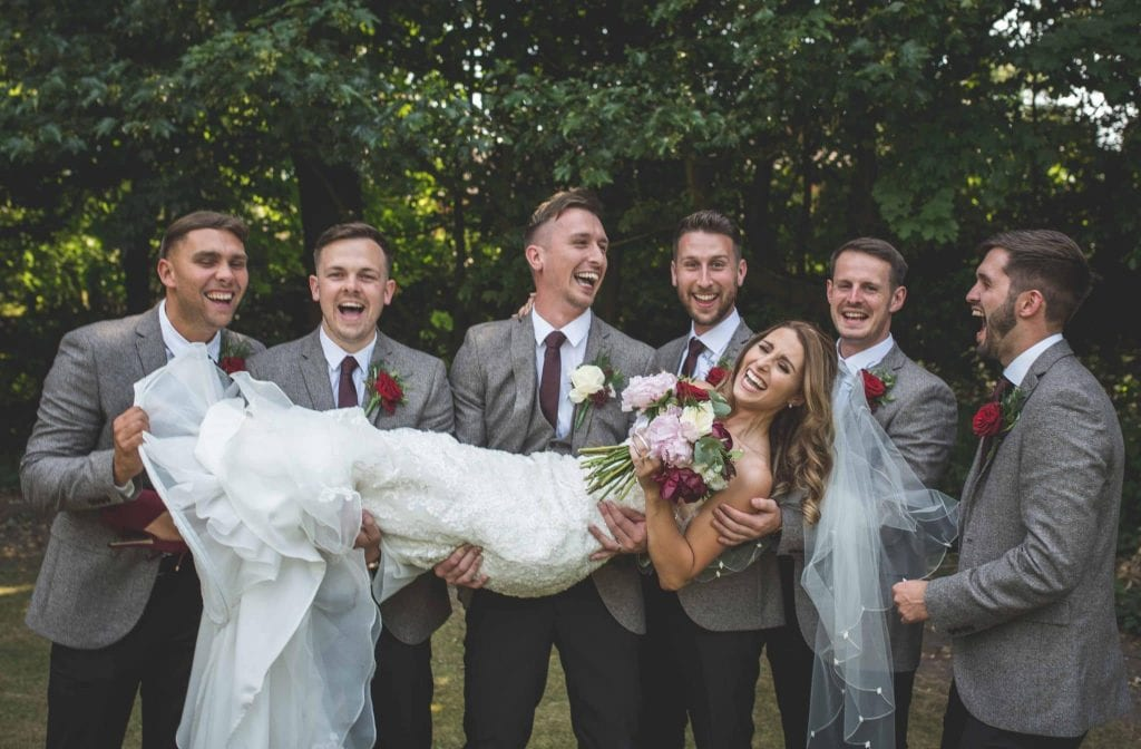 Bride being carried by groomsmen Ashfield House Wigan Wedding Photographer by Ollie Gyte Photography