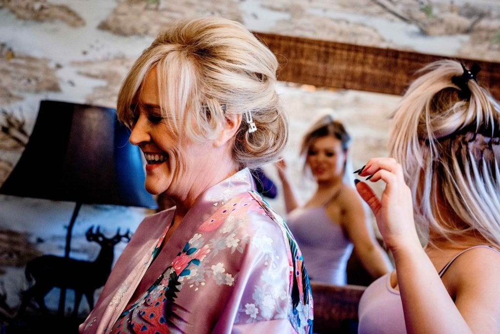 Mother of Bride laughing Eaves Hall Clitheroe Ollie Gyte