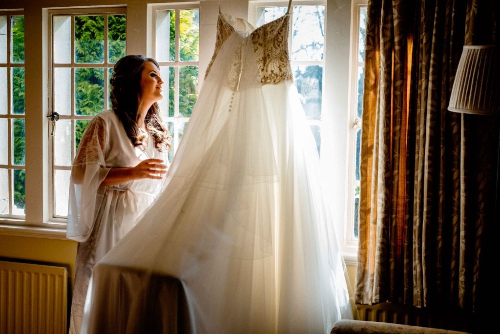 Bride admiring her dress photographed by Ollie Gyte Photography
