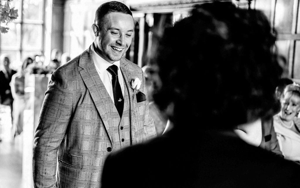 Groom Laughing Hallmark Hotel Frankby Wirral wedding photographer by Ollie Gyte Photography