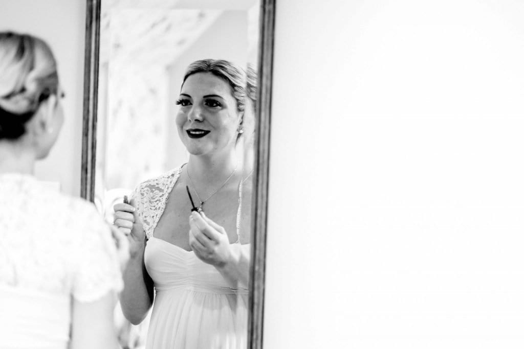 Bride and Mirror Lindeth Howe Hotel Windermere Wedding Photographer by Ollie Gyte Photography
