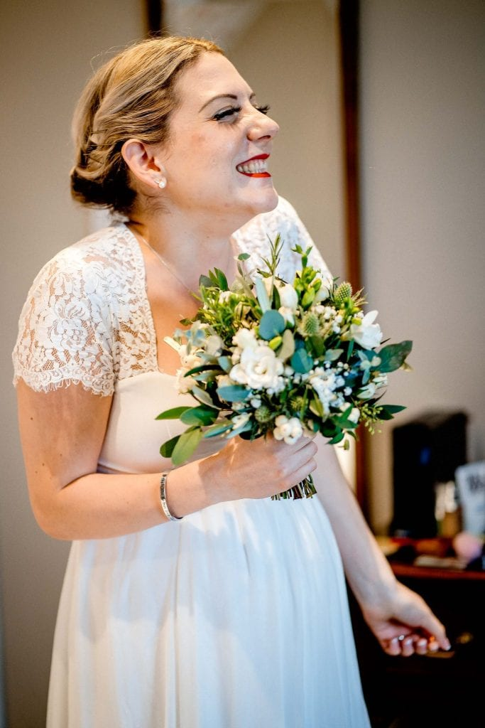 Excited Bride Lindeth Howe Hotel Windermere Wedding Photographer by Ollie Gyte Photography