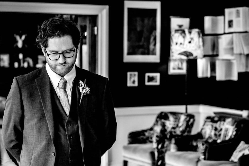 Groom waiting for Bride Lindeth Howe Hotel Windermere Wedding Photographer by Ollie Gyte Photography